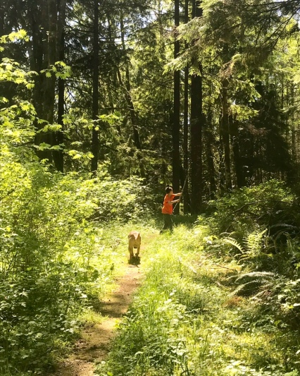 Boy Hiking with dog in PNW forest WA State