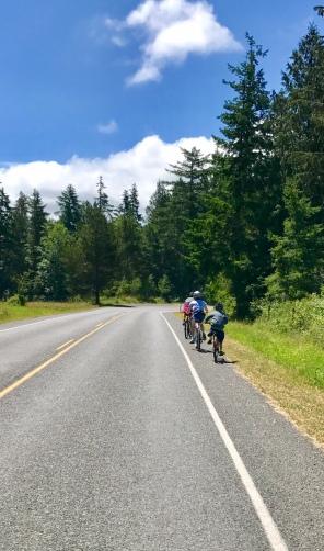 Biking along main road Lopez Island
